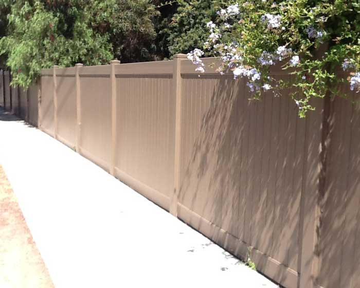 Wood colored privacy fence