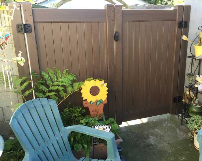 Wood colored vinyl gate